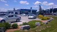 Gallery Image front_of_dealership_with_X1_in_Canada.jpg