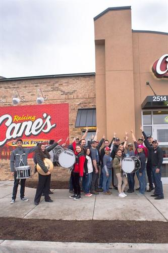 Morton High School Cheer and Drumline at Raising Cane's opening
