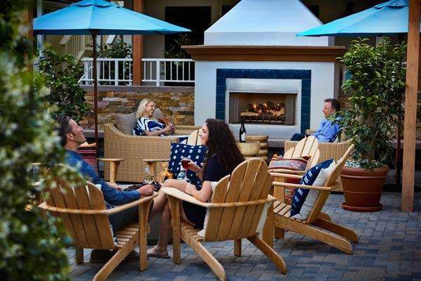 Circle up around the courtyard fire pit for wine and storytelling with your fellow Carmel-loving travelers.