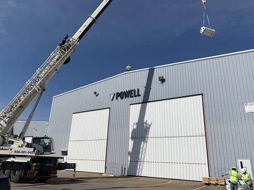 Powell Industries loading roof materials