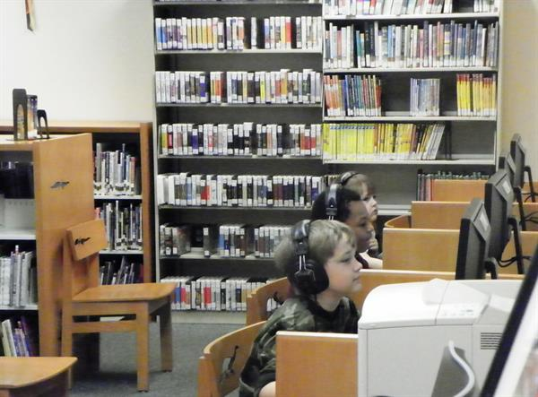 Kids play educational games on computers in the childrens area at the Southwest Branch Library