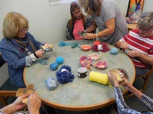 Making decorative baskets at the Southwest Branch Library with all materials supplied by the Friends of the Southwest Branch Library