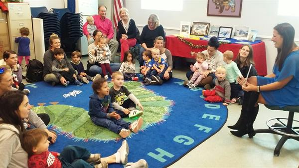 Local author Angel Stull-James reads her book 'Tuesday Bluesday' to children at storytime at the Southwest Branch Library