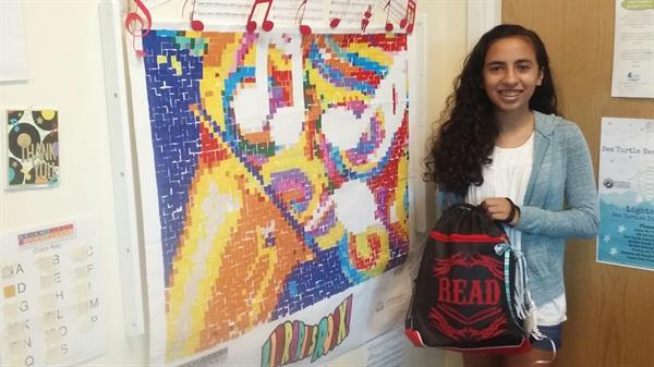Liliana was another prize winner in the Summer Reading Club raffle at Southwest Branch Library and received a book bag full of goodies.