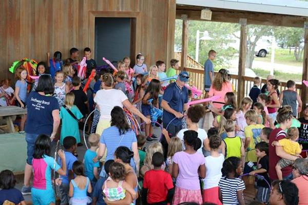 Children enjoy the end of summer reading club festivities at Big Lagoon State Park for the Southwest Branch Library