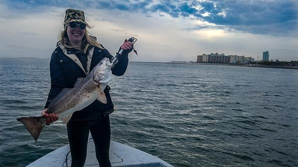 Young Woman Catches Monster Redfish