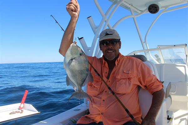 Taking photos of a clients fishing trip