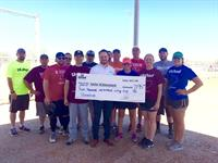 Team Members presenting a donation to Junior Achievement of Abilene. The money was raised through our company softball tournament.