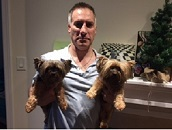 Me holding our furry and indulged children, Coco and Chanel