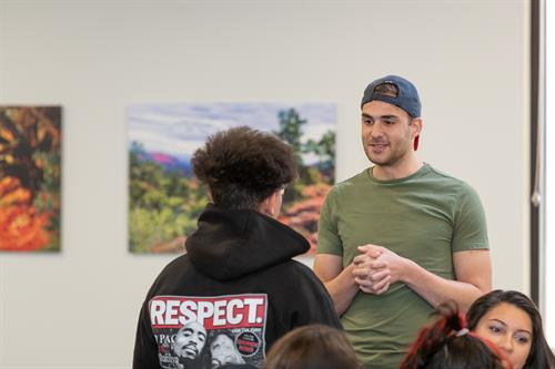 A mentor and youth acknowledging each other at a workshop