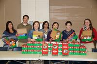 BECi employees packing shoeboxes for Operation Christmas Child.