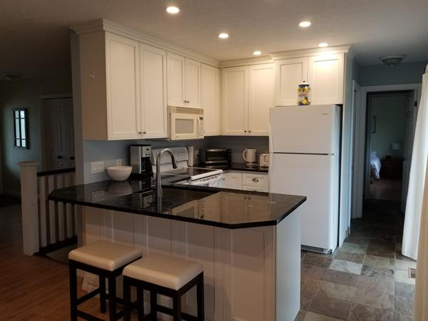 Kitchen with granite countertops and breakfast bar