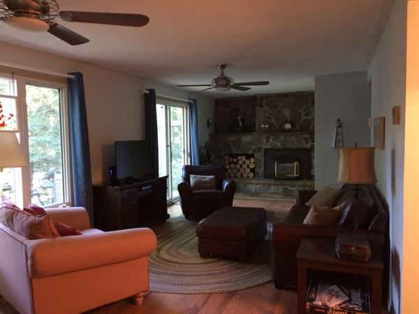 Living room with gas fireplace, flat screen, ceiling fans
