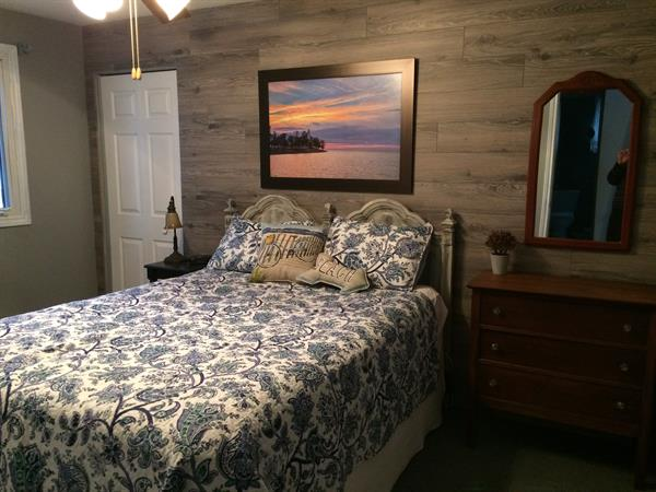 Master bedroom, queen bed, 2 closets, dresser, ceiling fan