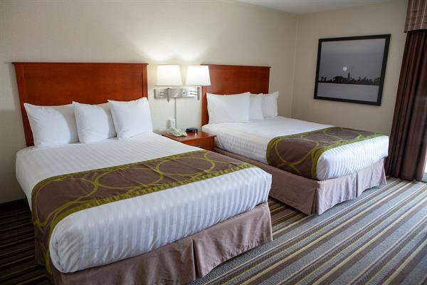 Traditional Rooms with 2 beds are available with walk outs to the courtyard or parking lot.