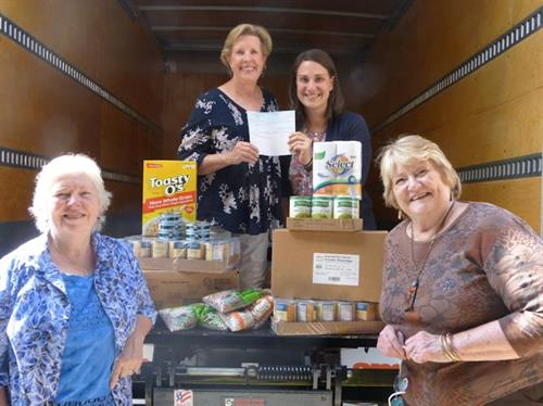 Special delivery to Rockbridge Area Relief Association: Jen accepted the Charske Fund UWR grant, designated for the new RARA truck! Front row, board member Janet and committee member, Carole. Back row, board member Deb with Jen, Executive Director, RARA.