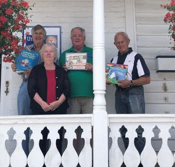 George, Janet, Lynn and Paul with a few of the books to be given to RARA.