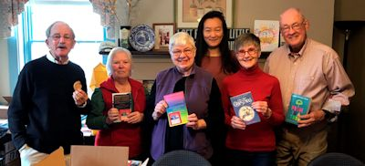 Santa's Elves getting children's books ready for Rockbridge Christmas Baskets.