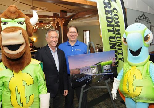 Picture taken at the 2019 Annual Meeting. WI Credit Union League President Brett Thompson and 1st CCU President Brad Bauges pictured with characters from 1st CCU's Centsables Youth Savings Program, along with a drawing of the new Tomah branch to be constructed later in 2019.