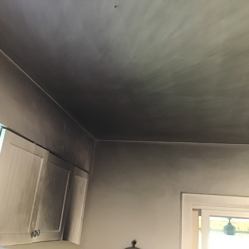 Soot on ceilings and walls.