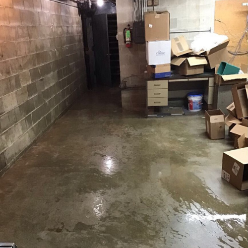 Water damage in unfinished basement.