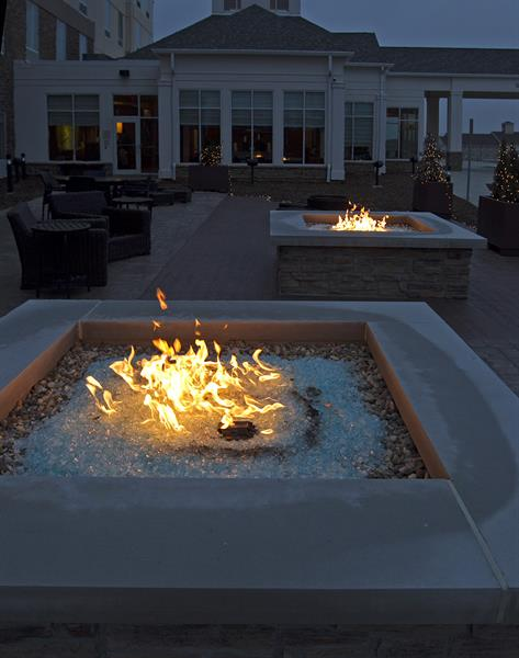 Two patios with fire pits