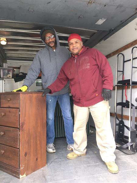 Herman, AFIL volunteer, and Gary, both are veterans but Gary was delivered some furniture for his apartment that was needed.