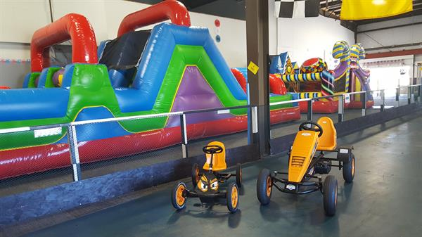Pedal Cars with Bounce houses in background