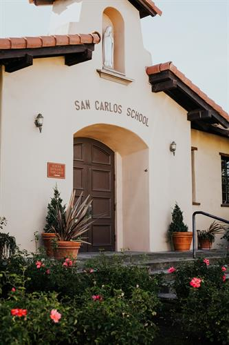 Gallery Image Front_of_school_with_flowers.jpg