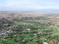 high above the golf course