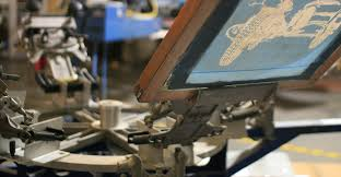 Automated screen printing press