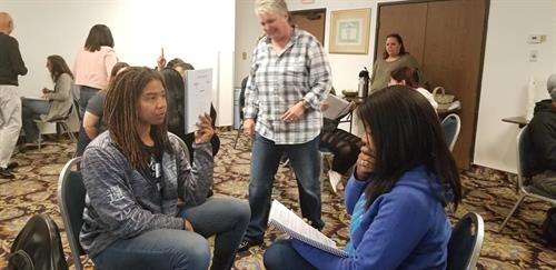 Students engaged in practicing NLP