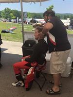 adjusting pro racer Victor Franzoni