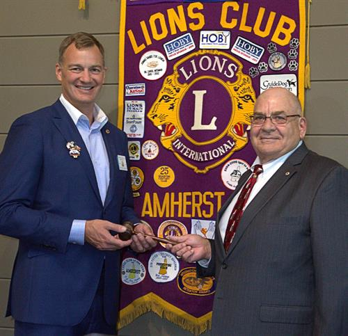 Amherst Lions recently installed Bob Gibson (right) as King Lion (president) for this term. Outgoing King Lion Brian McGuigan (left) hands over the gavel. Last term, the club donated more than $30,000 toward local charities, participated in 55 service activities and contributed more than 4,000 hours of local community service. (Photo by David McBee)