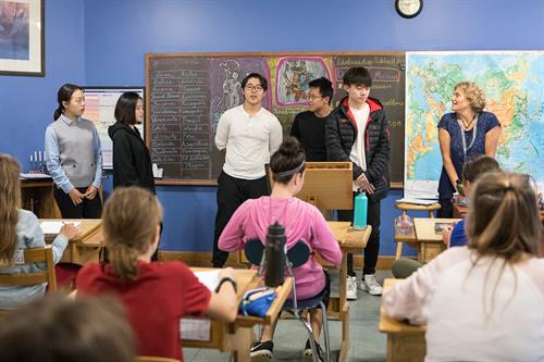 High School students visit the middle school and talk about Chinese culture and history.