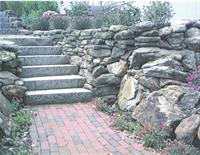 Brick walk with stone terrace and granite steps.