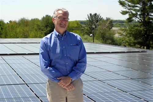 Rooftop array at Wire Belt Company in Londonderry with CEO David Greer.