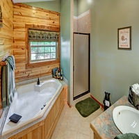 Jacuzzi tub for Two on main level of our Eureka Springs Cabin Rentals