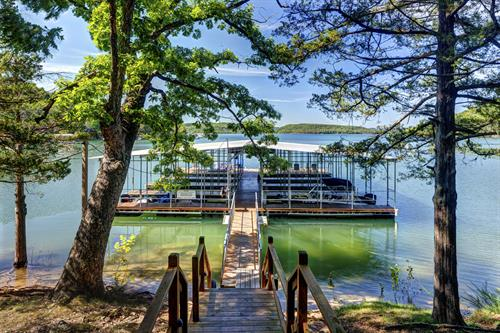 Covered Boat dock with slips and swim deck!