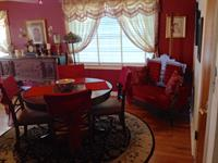 Dining nook with antique settee