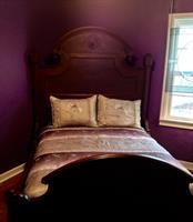 Pegasus bedroom with antique burl walnut bed