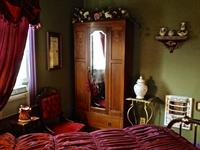 Rose bedroom with antique armoire