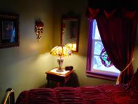 Rose bedroom with stained glass lamp and window