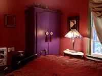 Crystal bedroom with violet armoire and stained glass lamp