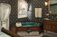 Tennyson's romantic jacuzzi in corner of the bedroom sets the mood