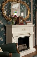 Tennyson's seasonal faux fireplace...sheer delight for those cozy Autumn evenings