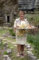 Innkeeper Sandra delivering one of her award-winning breakfasts