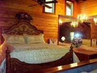 King-size bed and 2 person Jacuzzi in cabin 14