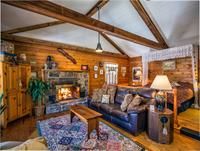 Fully-furnished cabins with kitchen, outdoor grill and covered porch with swing & rocking chairs