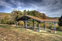 Covered picnic area with huge party grill --- seating for 40+